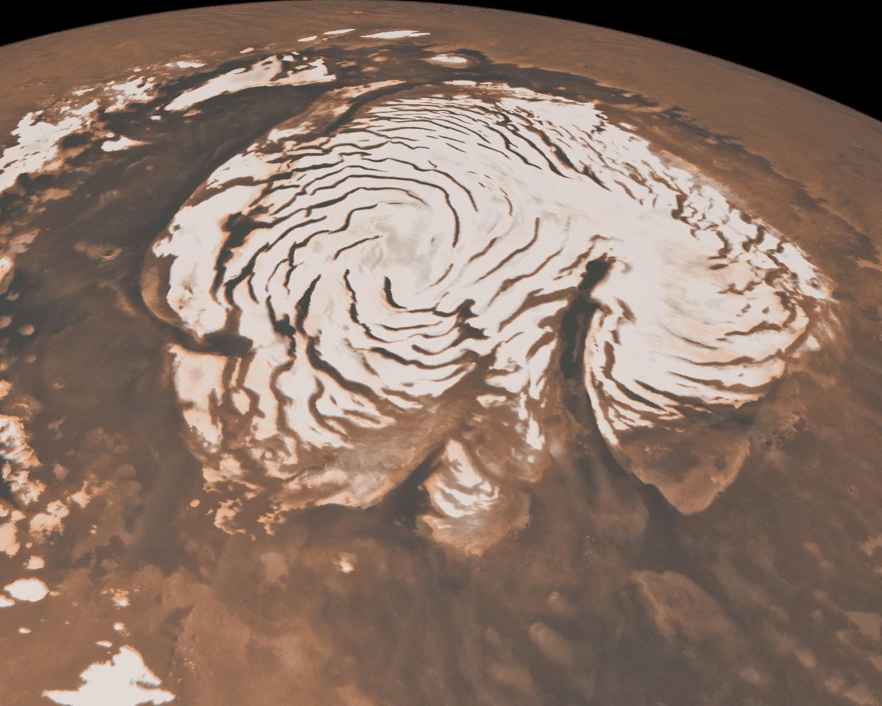 Die Eiskappen auf dem Nordpol unseres Nachbarplaneten Mars. Darunter gibt es wahrscheinlich Wasser. Gut möglich, sagt Daniel Angerhausen, dass sich darin Bakterien tummeln.