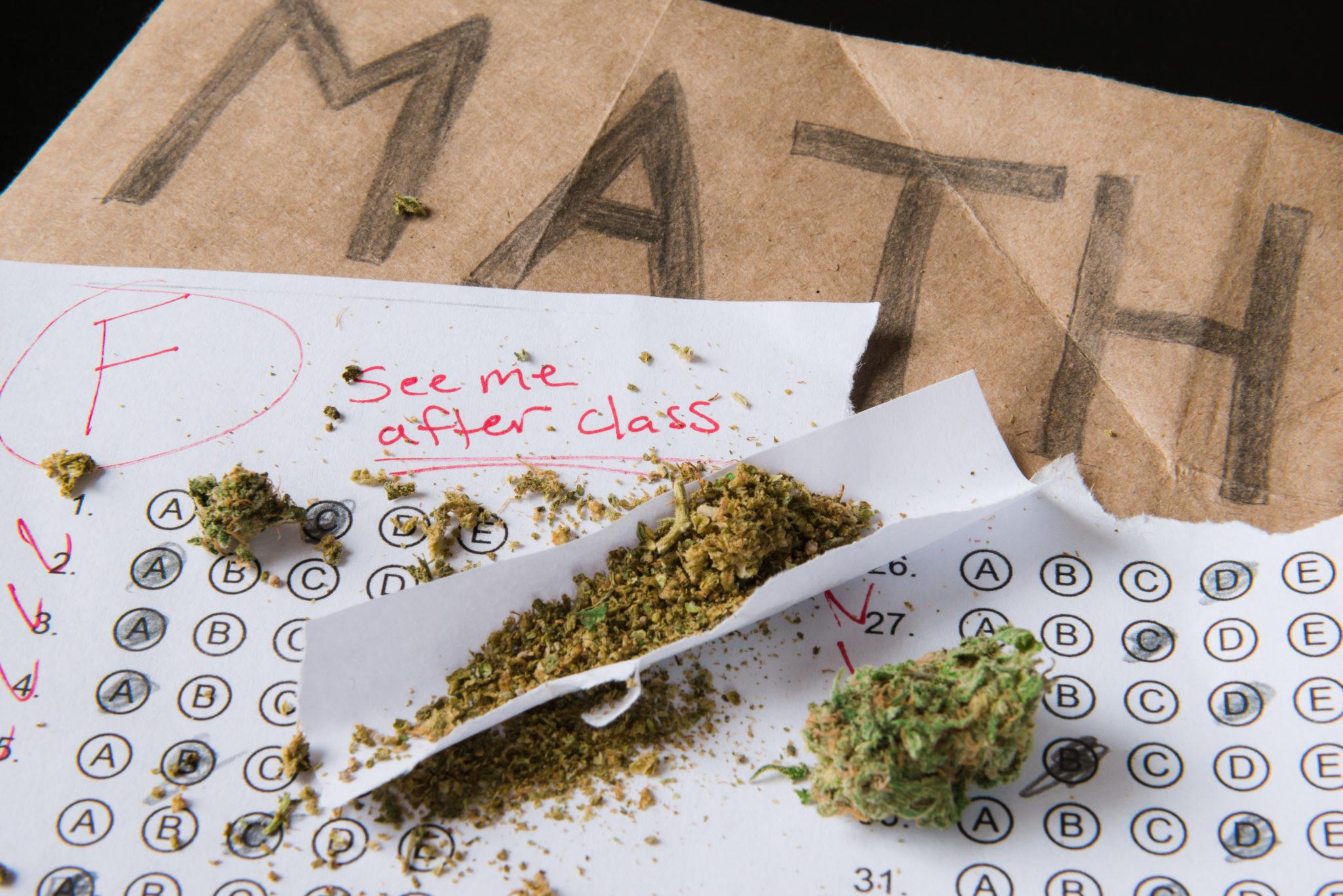 A failed test on a math book with Marijuana.