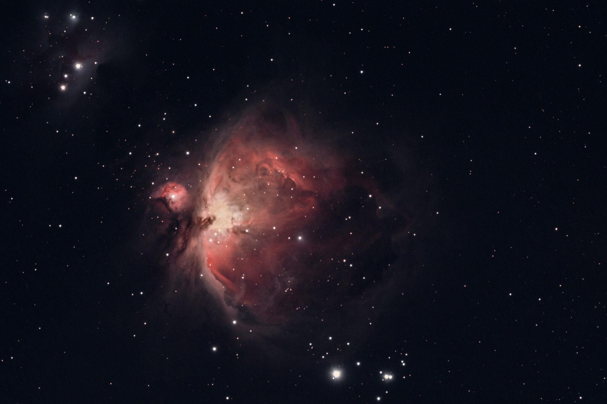 Sterne und ein schwarzes Loch (?), umgeben von schwarz