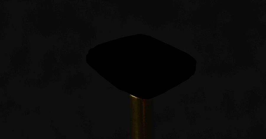 Diamant, mit dem bisher dunkelsten Material beschichtet, vor schwarzem Hintergrund. Der Diamant ist nicht zu erkennen.