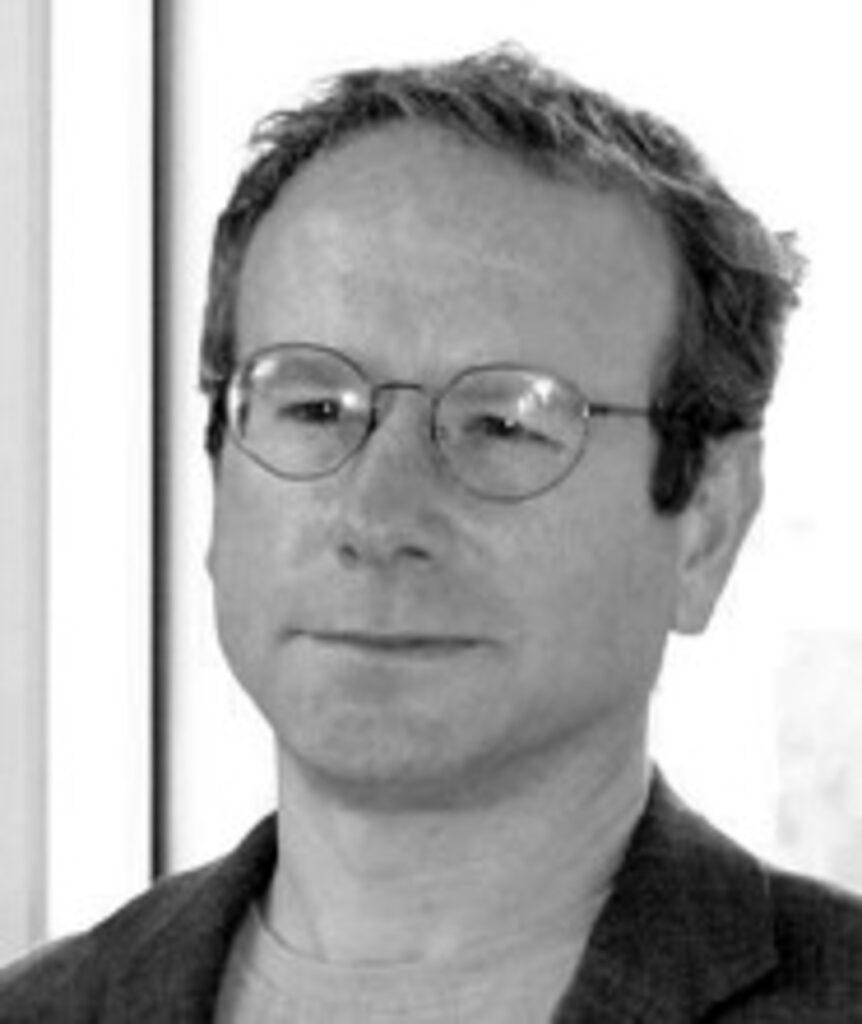 Schwarzweiss Portrait von John Wolff mit Brille